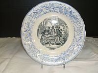 French Transferware Plate-French, illustration in black & white.  Blue pattern around plate. Paris au Bal scene